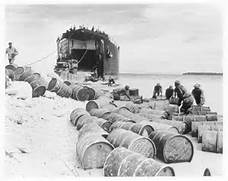 Fuel drums being unloaded on Biak