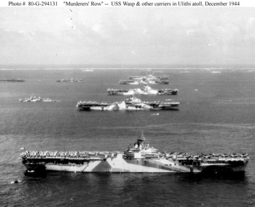 Third Fleet aircraft carriers at anchor in Ulithi Atoll, 8 December 1944, during a break from operations in the Philippines area. The carriers are (from front to back): USS Wasp (CV-18), USS Yorktown (CV-10), USS Hornet (CV-12), USS Hancock (CV-19) and USS Ticonderoga (CV-14). Wasp, Yorktown and Ticonderoga are all painted in camouflage Measure 33, Design 10a. Photographed from a USS Ticonderoga plane. Official U.S. Navy Photograph, now in the collections of the National Archives (Photo #: 80-G-294131).